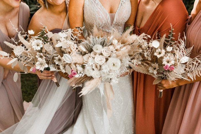 Bride and Bridesmaids Holding Modern Boho Wedding Bouquets at Lakeside Wedding
