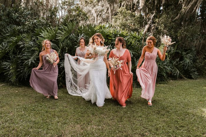 Bridesmaids in Mismatched Gowns Walking with Real Bride Wearing Maggie Sottero Sheath Wedding Dress