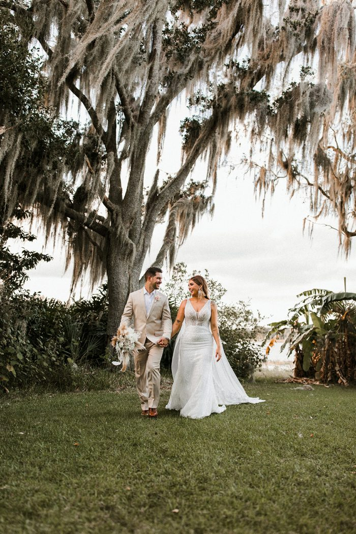 Bride Walking with Real Bride Wearing Sparkly Sheath Wedding Dress Called Elaine by Maggie Sottero