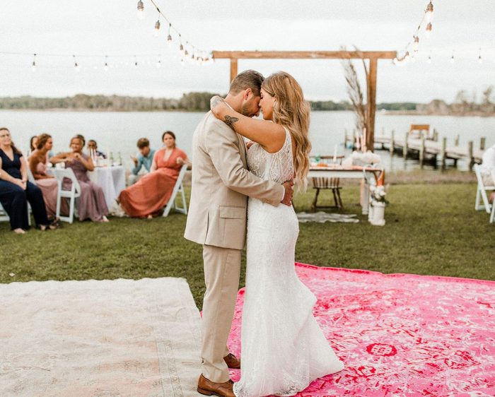 Groom Dancing with Real Bride Wearing Beaded Sheath Wedding Dress Called Elaine by Maggie Sottero