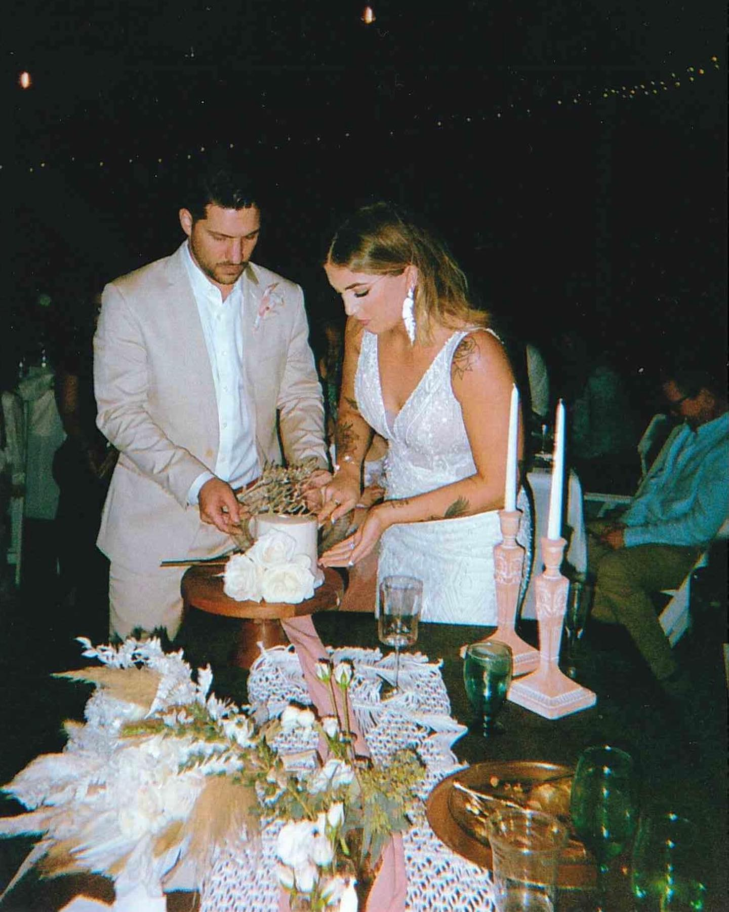 Bride and Groom Cutting a Gluten-Free DIY Wedding Cake at Affordable Outdoor Wedding