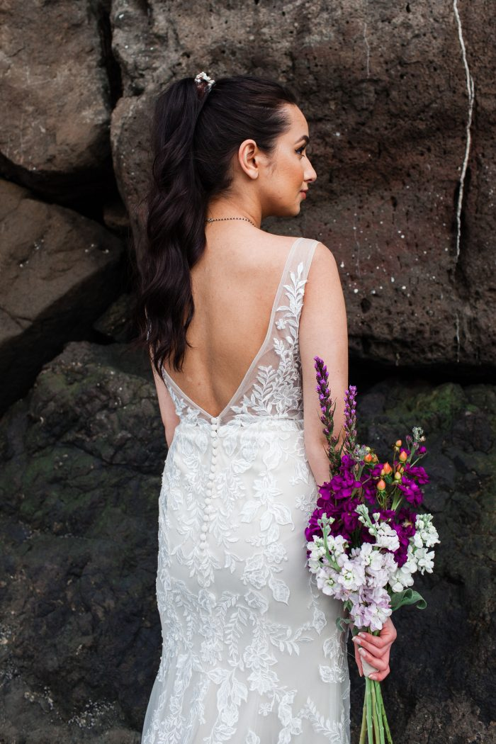 Bride From Back Wearing V-back Beach Wedding Dress by Maggie Sottero and Slicked-back Ponytail