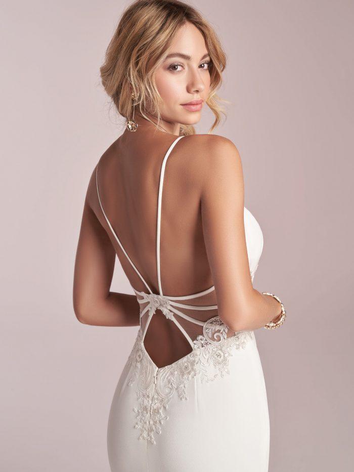 Model Wearing Open Back Crepe Sheath Wedding Dress Called Cody by Rebecca Ingram