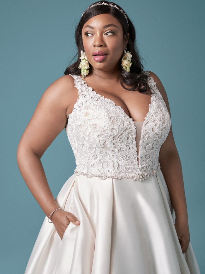 Curvy Model Wearing Plus Size Satin Princess Wedding Gown Called Sonnet by Maggie Sottero