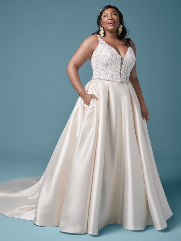Plus Size Model Wearing Plus Size Satin Princess Wedding Gown Called Sonnet by Maggie Sottero
