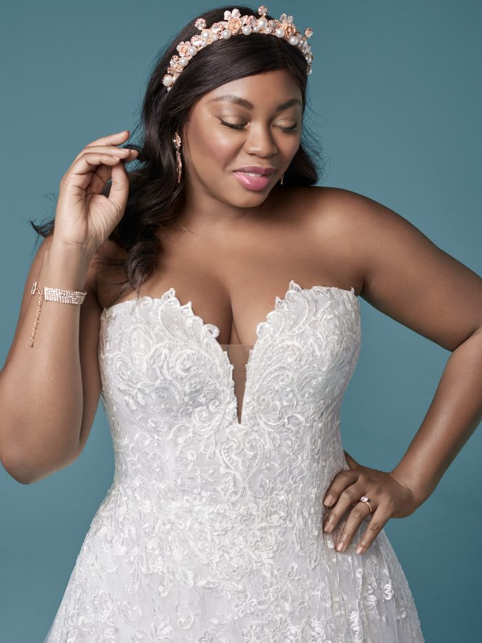 Curvy Model Wearing Plus Size Strapless Ball Gown Wedding Dress Called Tennyson by Maggie Sottero