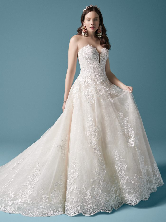 Model Wearing Sparkly Lightweight Ball Gown Wedding Dress Called Tennyson by Maggie Sottero