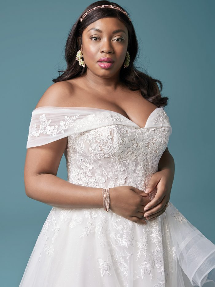 Plus Size Model Wearing Curvy Off-the-Shoulder Wedding Dress Called Zariah by Maggie Sottero