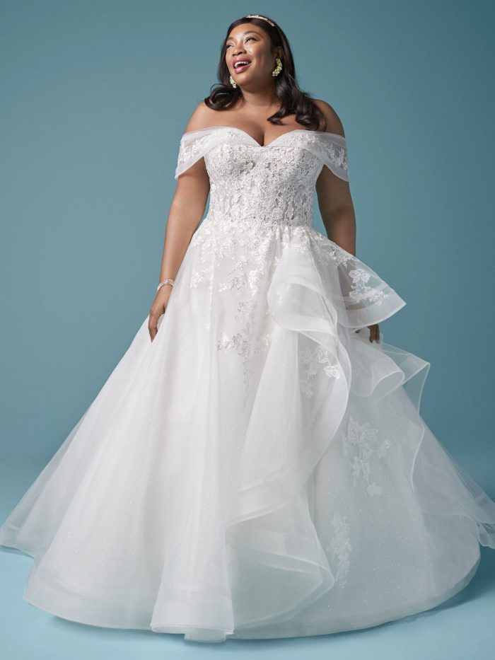 Plus Size Model Wearing Curvy Princess Wedding Dress Called Zariah by Maggie Sottero