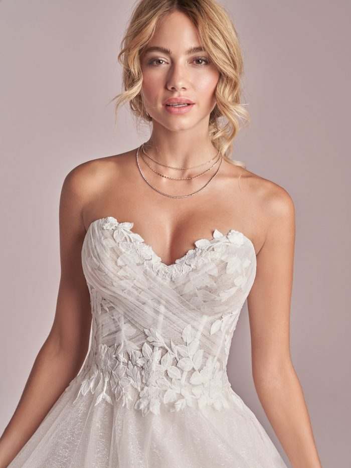 Model Wearing Strapless Princess Wedding Gown Called Remy by Rebecca Ingram