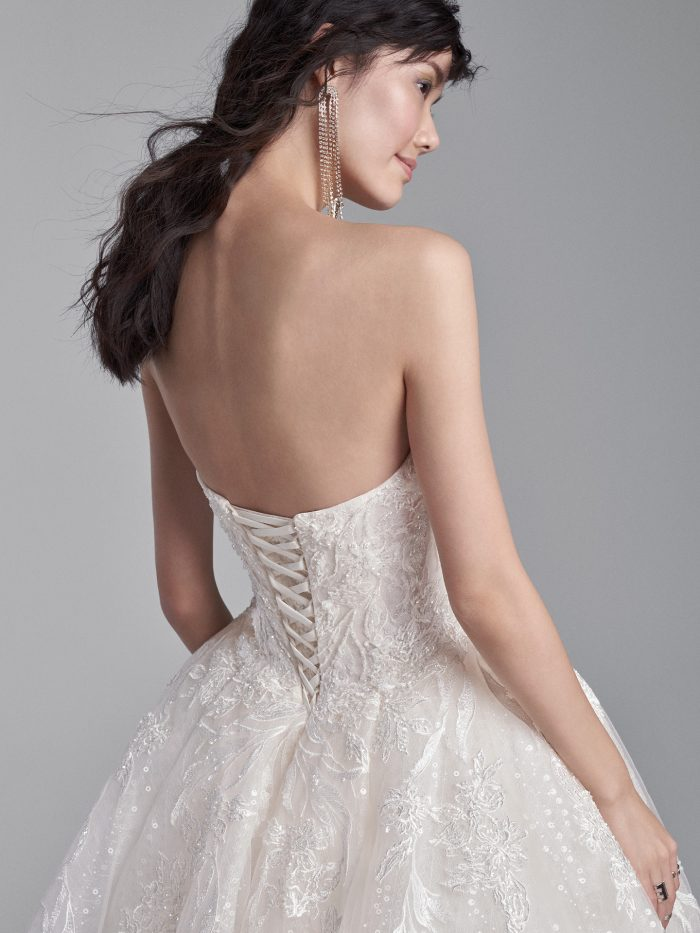 Model Wearing Strapless Ball Gown Wedding Dress with Corset Called Troy by Sottero and Midgley