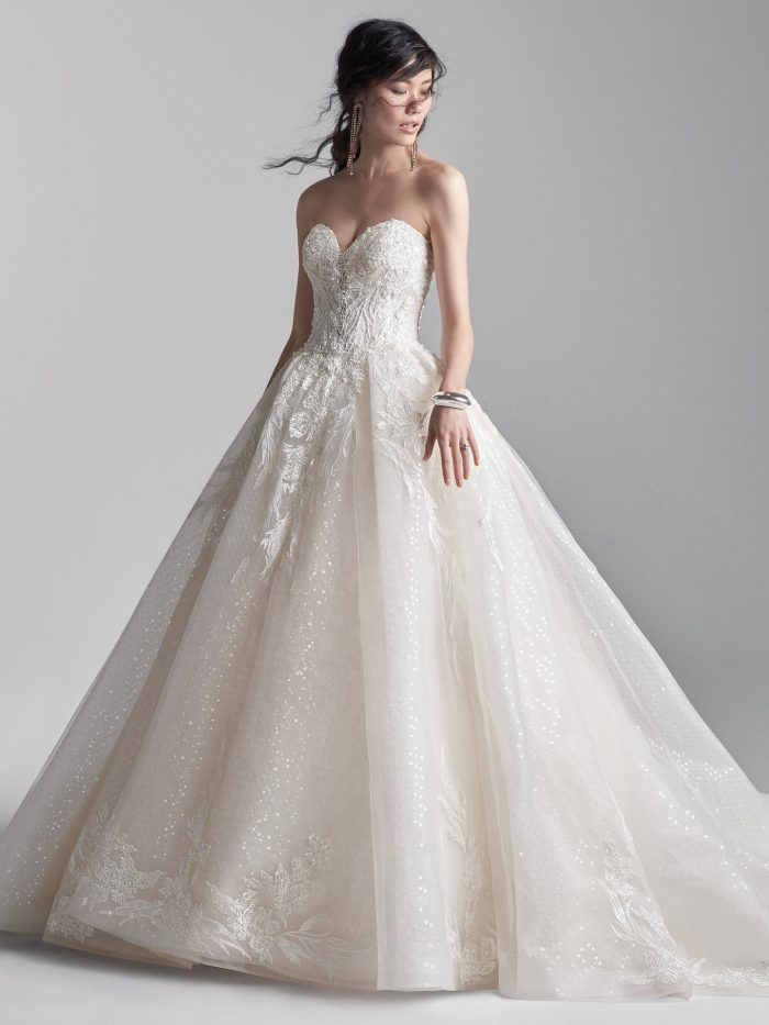 Model Wearing Strapless Tulle Ball Gown Wedding Dress Called Troy by Sottero and Midgley