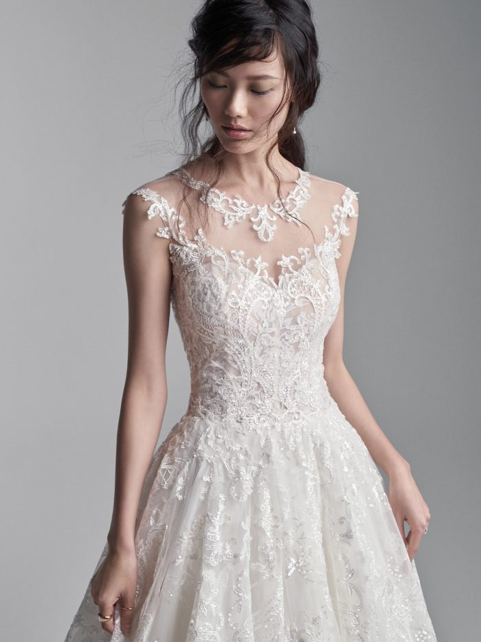 Model Wearing Long Train Ball Gown Wedding Dress Called Xavier by Sottero and Midgley