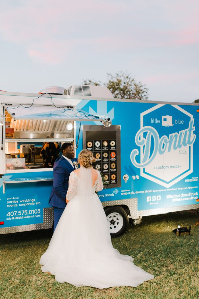 Real Bride and Groom Standing in Front of Homemade Donut Truck