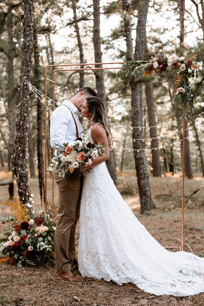 Groom Kissing Bride Wearing Boho Lace A-line Wedding Gown Called Finley Dawn by Sottero and Midgley at Outdoor Wedding