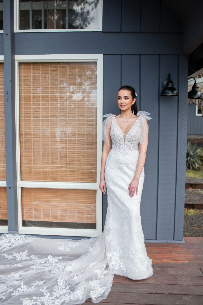 Bride at Beach House Wearing Fit-and-Flare Wedding Dress Called Easton by Sottero and Midgley