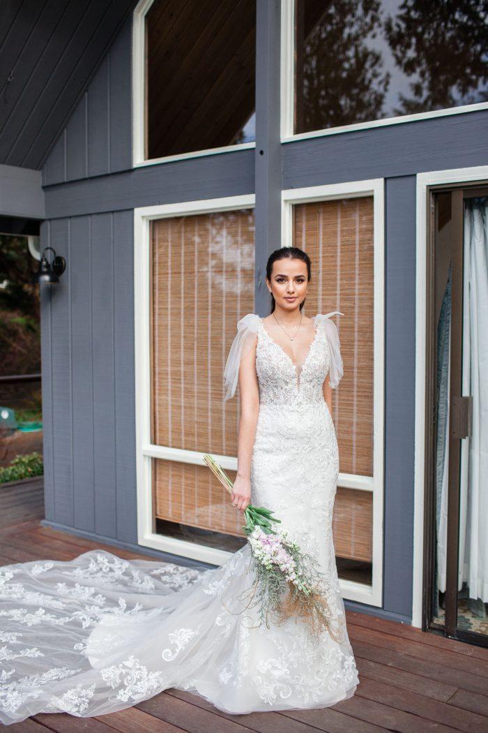 Bride at Blue Beach House Holding Wild Flower Wedding Bouquet for Beach Wedding