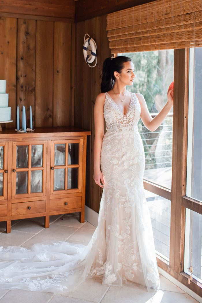 Bride in Beach House Wearing Floral Sheath Wedding Dress Called Greenley by Maggie Sottero
