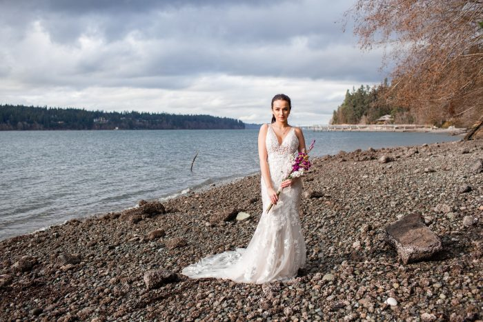 Bride on Beach Wearing Floral Beach Wedding Dress Called Greenley by Maggie Sottero
