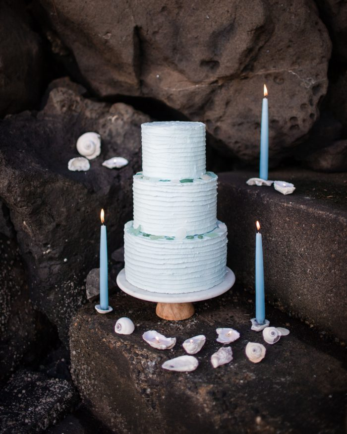 Blue Beach Wedding Cake with Blue Candles and Seashells