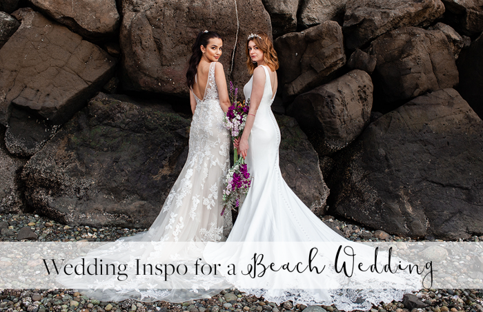 Two Models Standing by Each Other on Beach Wearing Beach Wedding Dresses by Maggie Sottero