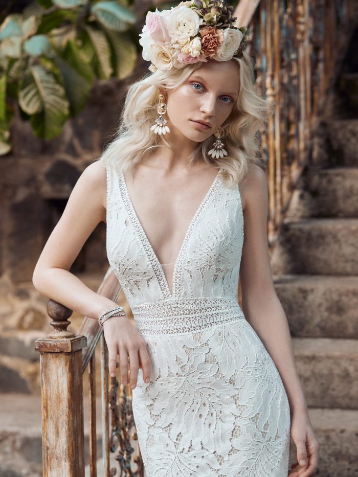 Model Wearing Nature-inspired Lace Sheath Wedding Dress Called Burke Made by Maggie Sottero