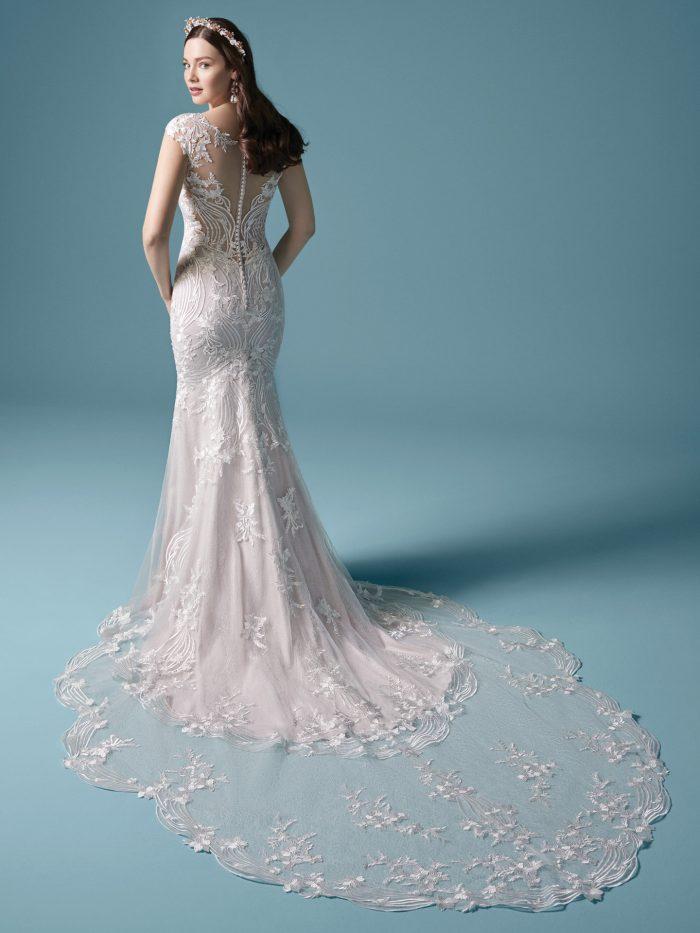 Model Wearing Long Train Boho Wedding Dress Called Keenan by Maggie Sottero