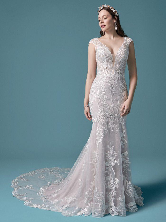 Model Wearing Cap-sleeve Boho Wedding Dress Called Keenan by Maggie Sottero