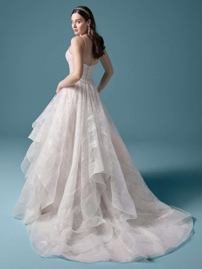 Model Wearing Princess Sequin Ball Gown Wedding Dress Called Zuri Made by Maggie Sottero