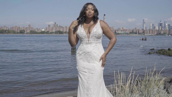 Black Plus Size Model Wearing Floral Sheath Wedding Dress Called Angie by Rebecca Ingram