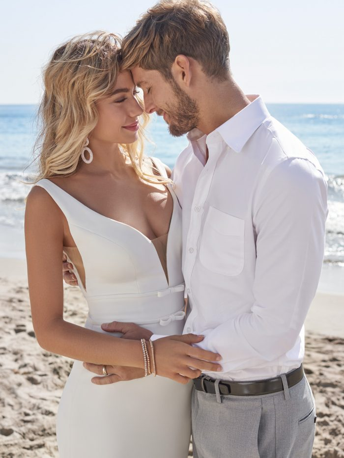 Groom with Bride on Beach Wearing Simple Affordable Wedding Dress Called Danica by Rebecca Ingram