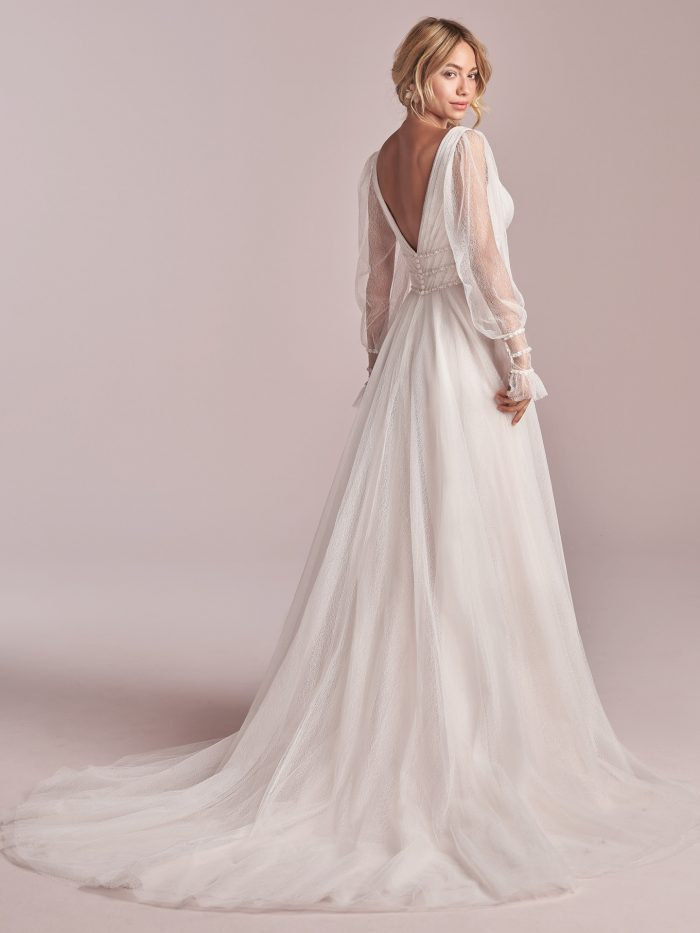 Model Wearing Sheer Bishop Sleeve Lightweight A-line Wedding Gown Called Joanne by Rebecca Ingram