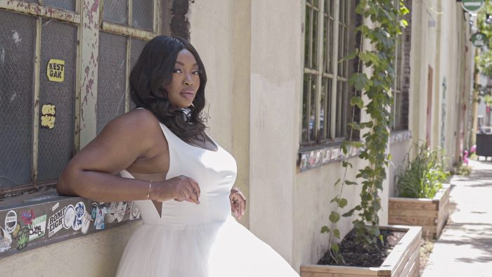 Plus Size Model Wearing Curvy Minimalist Ball Gown Wedding Dress Called Rosemary by Rebecca Ingram