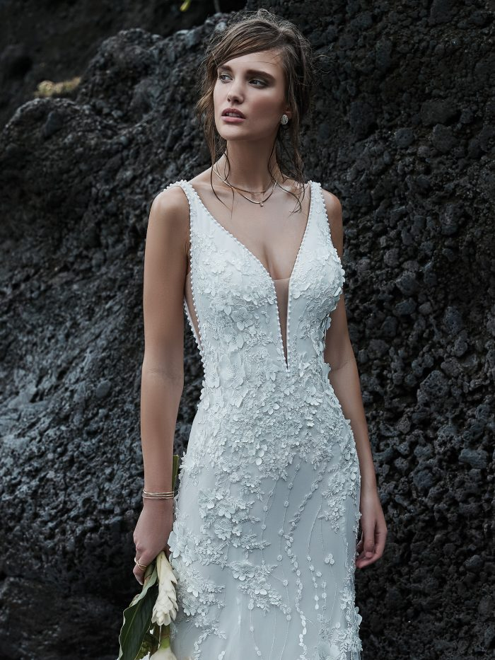 Bride on Beach Wearing Wedding Dress with 3-D Lace Floral Motifs Called Cruz by Sottero and Midgley