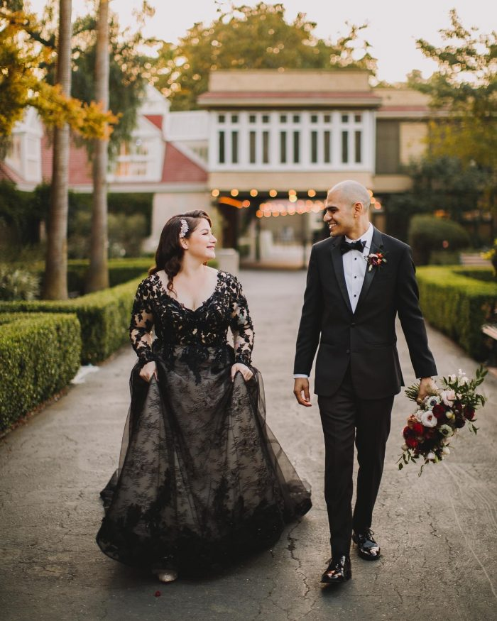 Bride Wearing Black Wedding Dress and Wedding Hairstyle for Thin Hair with Hair Accessory