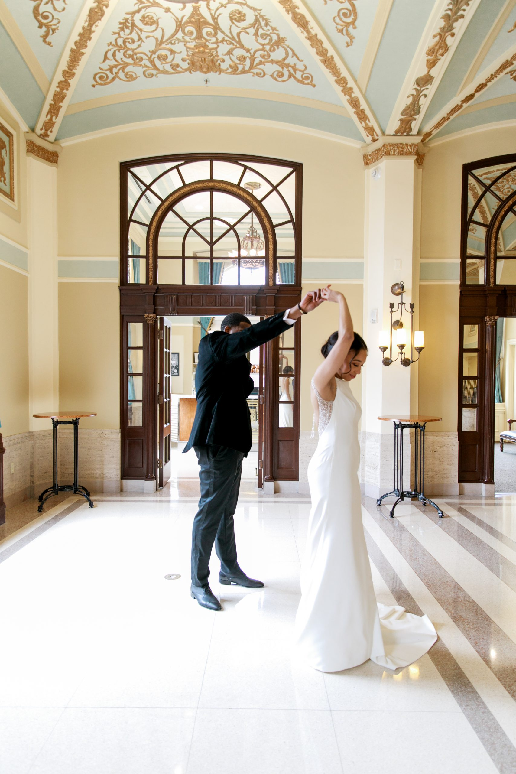 Groom with Real Bride Spinning in Chic and Classic Wedding Dress Evangelina by Maggie Sottero