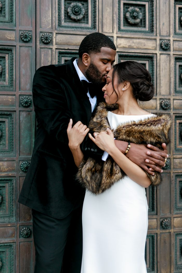 Groom Holding Real Bride Wearing Chic Elegant Wedding Dress Called Evangelina by Maggie Sottero