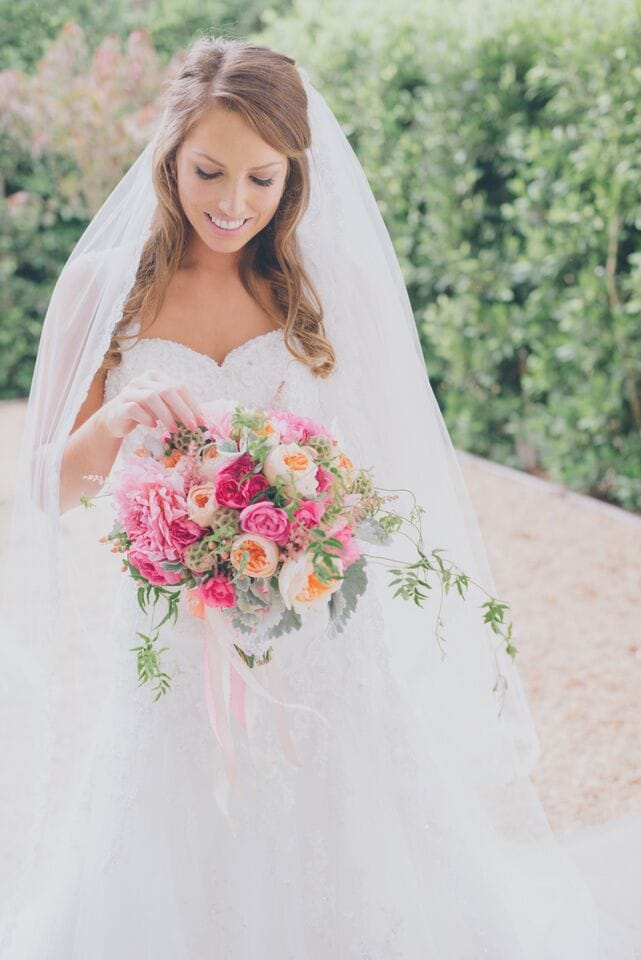 Maggie Bride, Kari, wearing our Lorie wedding dress in her happy Los Angeles wedding