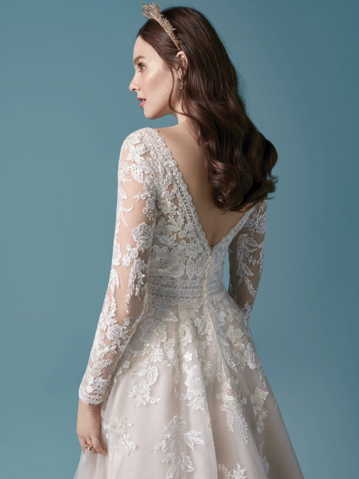 Model Wearing Romantic Illusion Sleeve A-line Wedding Dress Called Raphael by Maggie Sottero