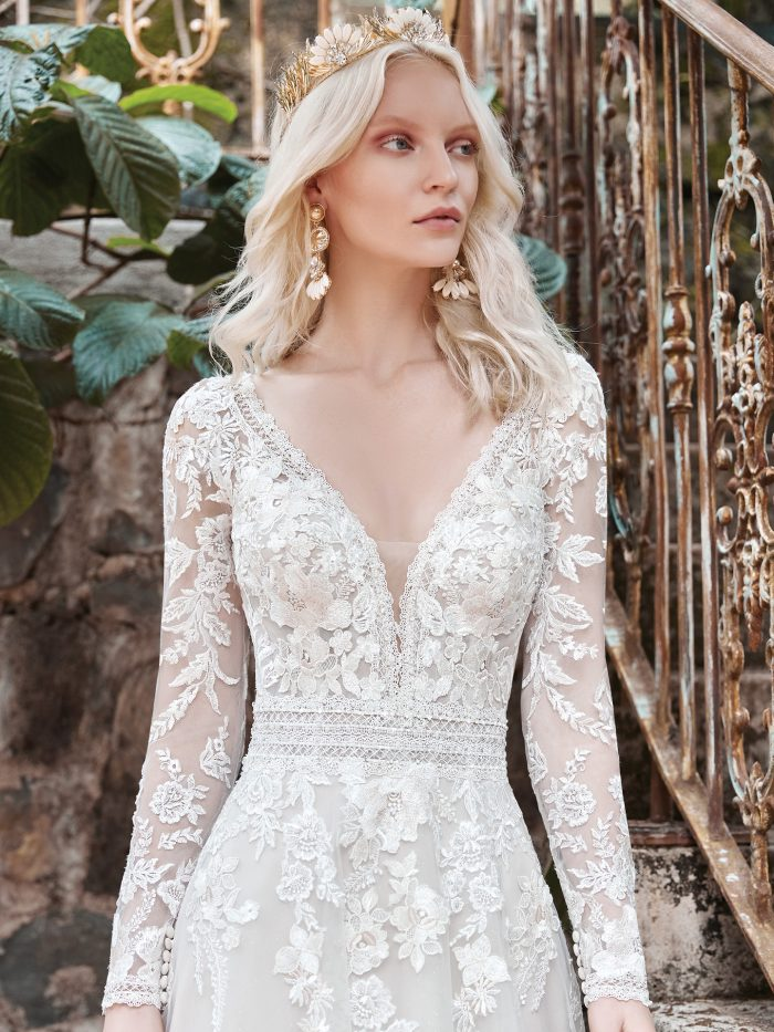 Model Wearing Floral Illusion Sleeve A-line Wedding Dress Called Raphael by Maggie Sottero