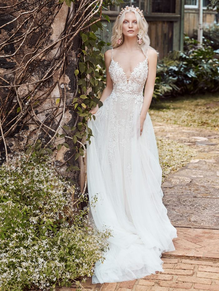 Model Wearing Boho A-line Wedding Dress with Sheer Bodice Called Roanne Rose by Maggie Sottero