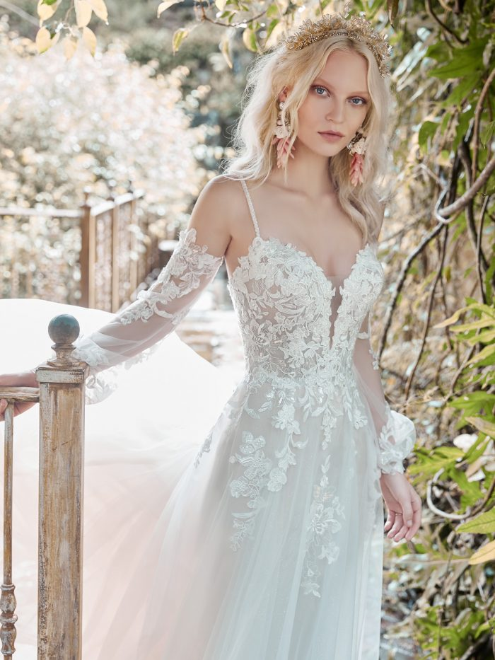 Model Wearing Cold Shoulder Bishop Sleeve Princess Wedding Dress Called Stevie by Maggie Sottero