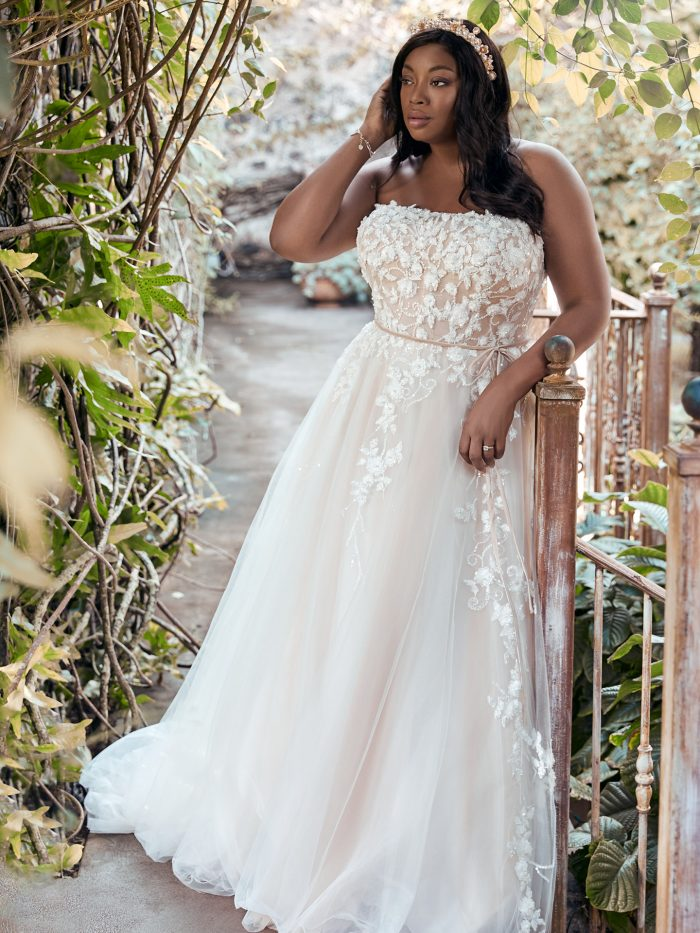 Plus Size Model Wearing Floral Lace Plus Size A-line Wedding Dress Called Zareen Lynette by Maggie Sottero