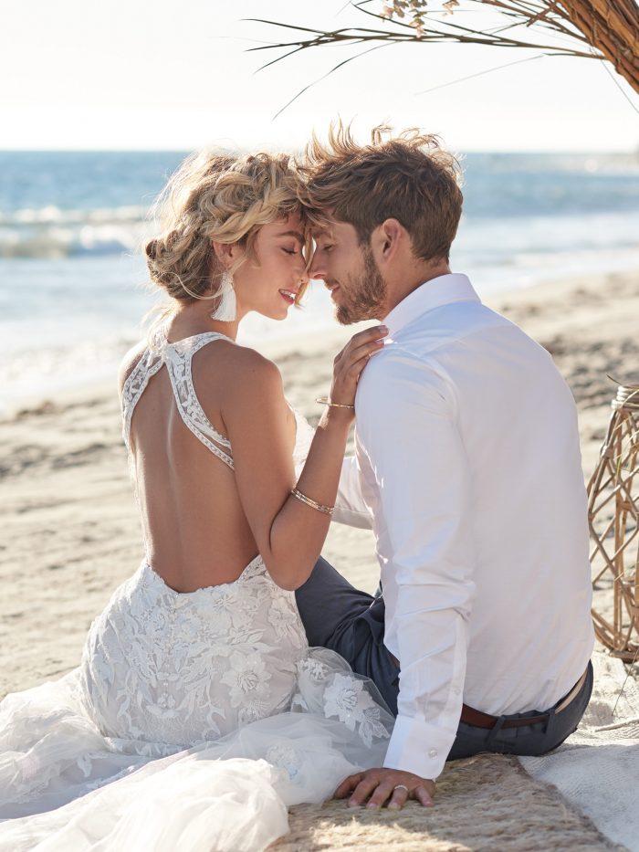 Groom with Bride on Beach Wearing Dramatic Back Wedding Dress Called Elizabetta by Rebecca Ingram