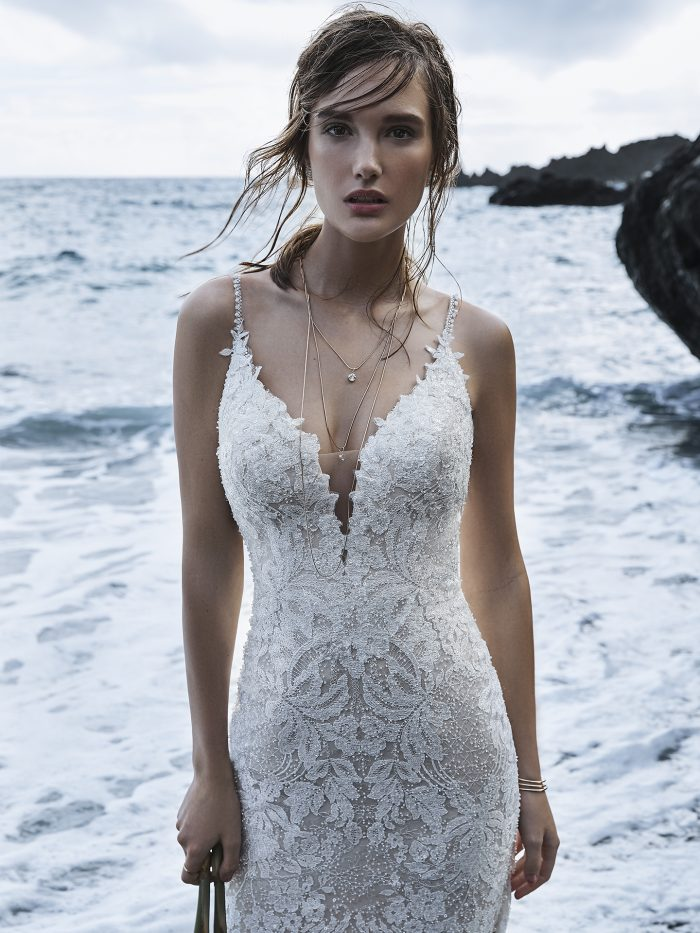 Model on Beach Wearing Sexy Floral Sheath Wedding Dress with Long Train Called Canterbury Marie by Sottero and Midgley