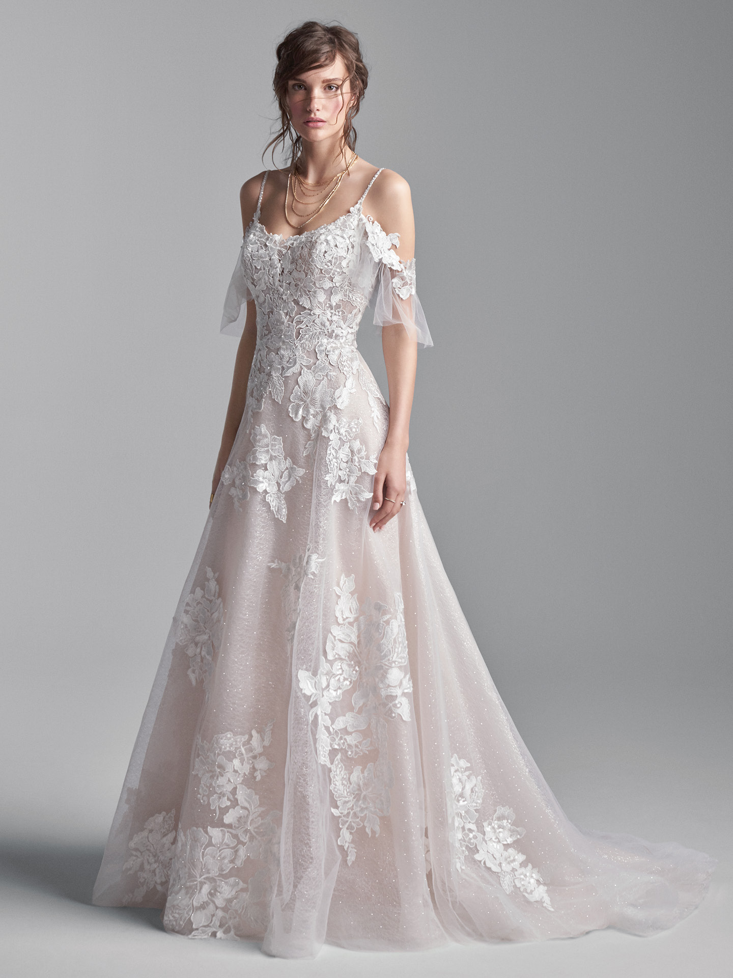 Model Wearing Cold Shoulder Floral Lace A-line Wedding Gown Called Houston by Sottero and Midgley