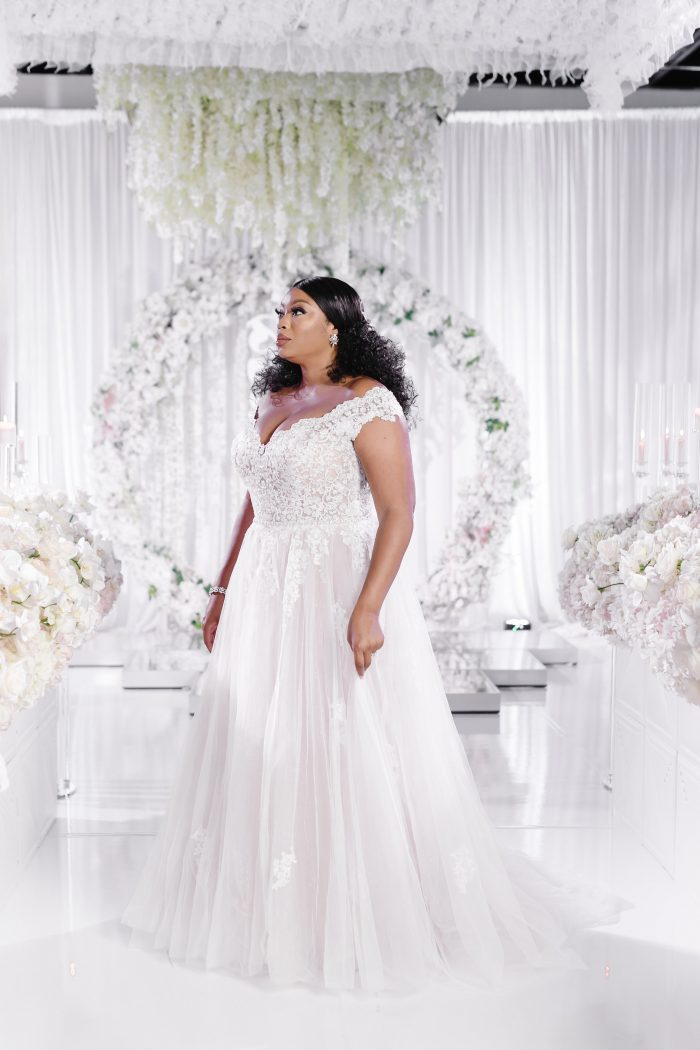 Curvy Black Model Wearing Plus Size Princess Wedding Dress Called Natalie by Maggie Sottero