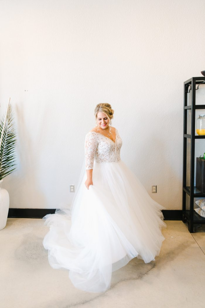 Curvy Bride Spinning in Princess Bridal Gown Called Mallory Dawn by Maggie Sottero