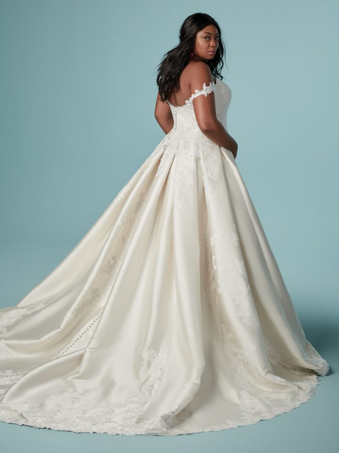 Curvy Black Bride Wearing Off-the-Shoulder Satin Ball Gown Wedding Dress Called Sheridan by Maggie Sottero