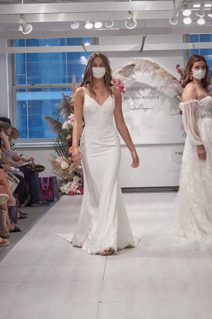 Model Walking Down the Runway at Chicago Bridal Market and Wearing V-neck Wedding Dress Called Copeland by Sottero and Midgley